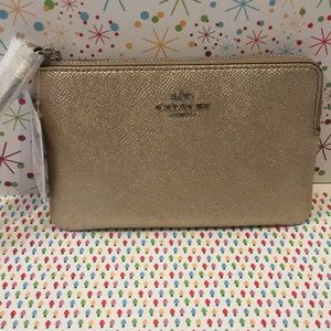 NWT Coach leather wristlet in Platinum.  6 x 4